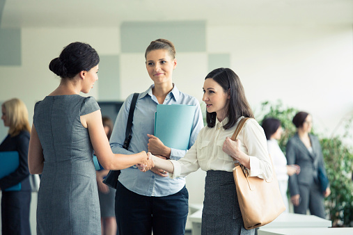 Three Businesswomen Talking In An Office Stock Photo - Download Image Now