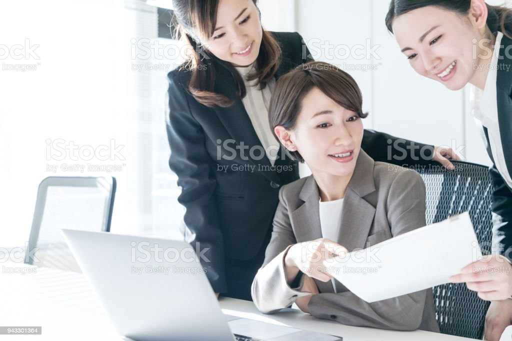 Three businesswomen working in the office. Positive workplace concept. stock photo