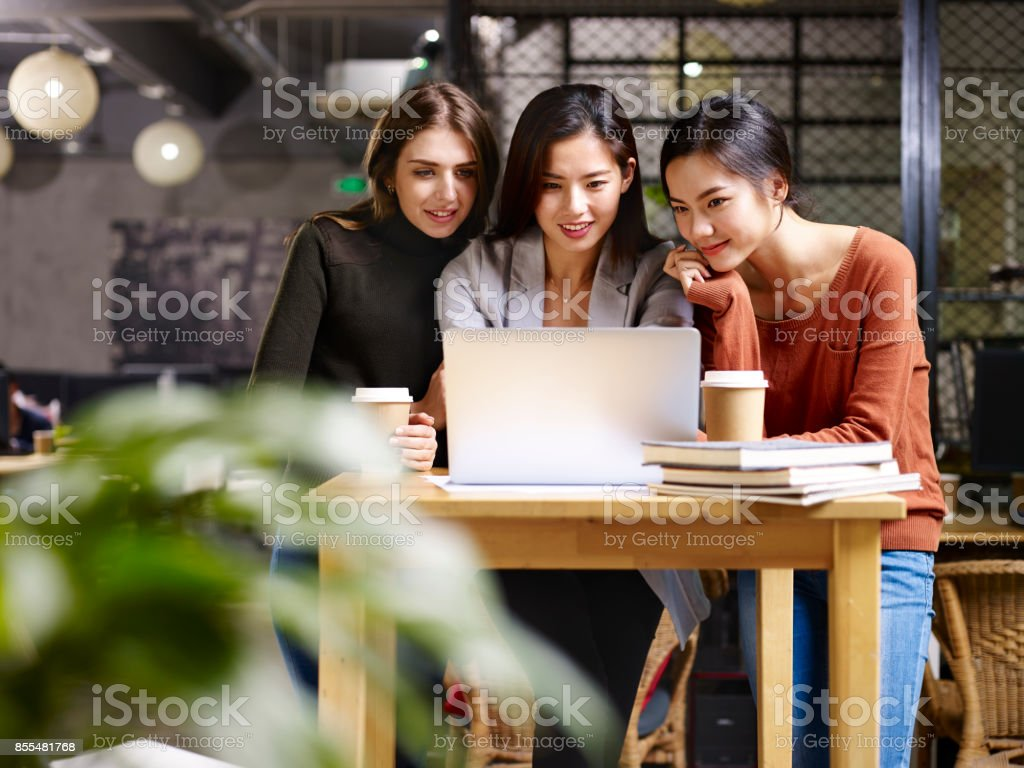 three businesswomen working together in office stock photo