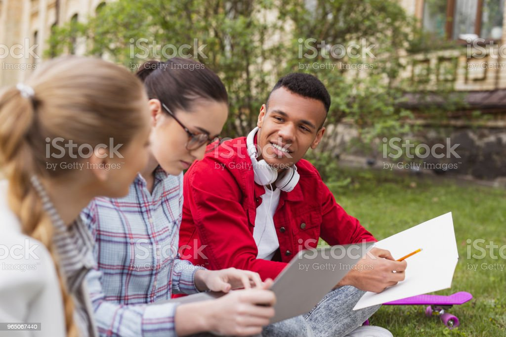 Three busy students feeling overloaded making home task royalty-free stock photo