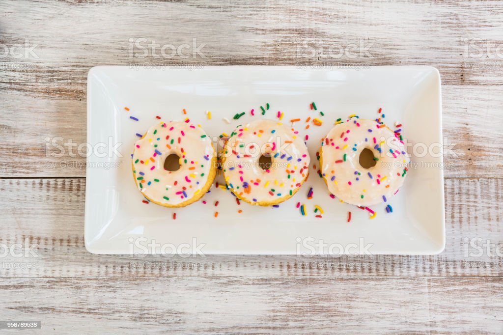 Three Cake Donuts With Sprinkles stock photo