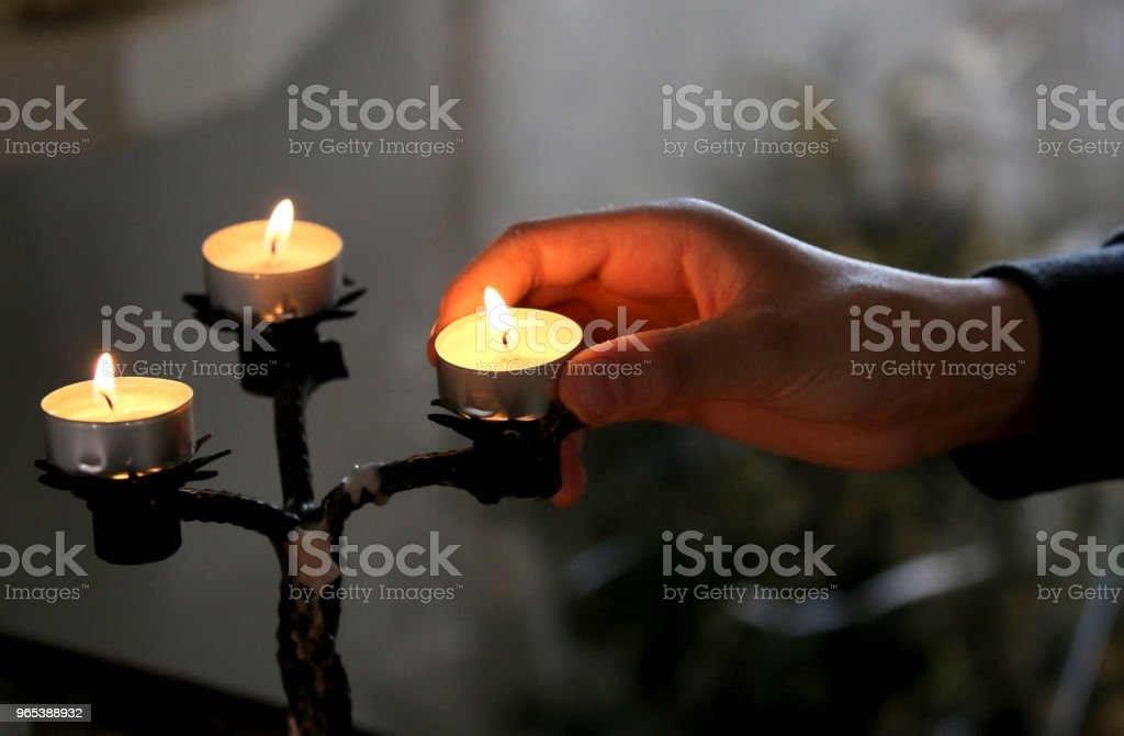 three candles in the church and an hand royalty-free stock photo
