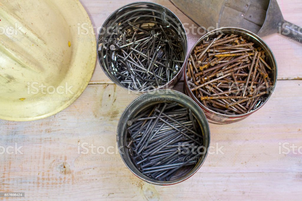 Three Cans of rusty nails stock photo