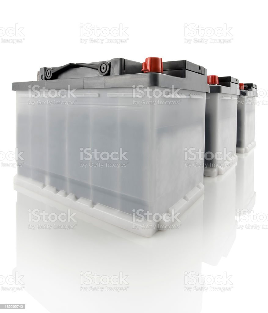Three car batteries against a white background stock photo