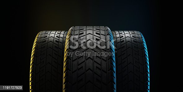 istock Three car tires lined up. 3d illustration 1191727523