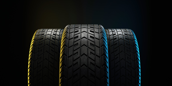 istock Three car tires lined up. 3d illustration 1191727523