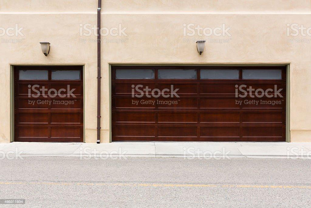 three car wooden garage door stock photo