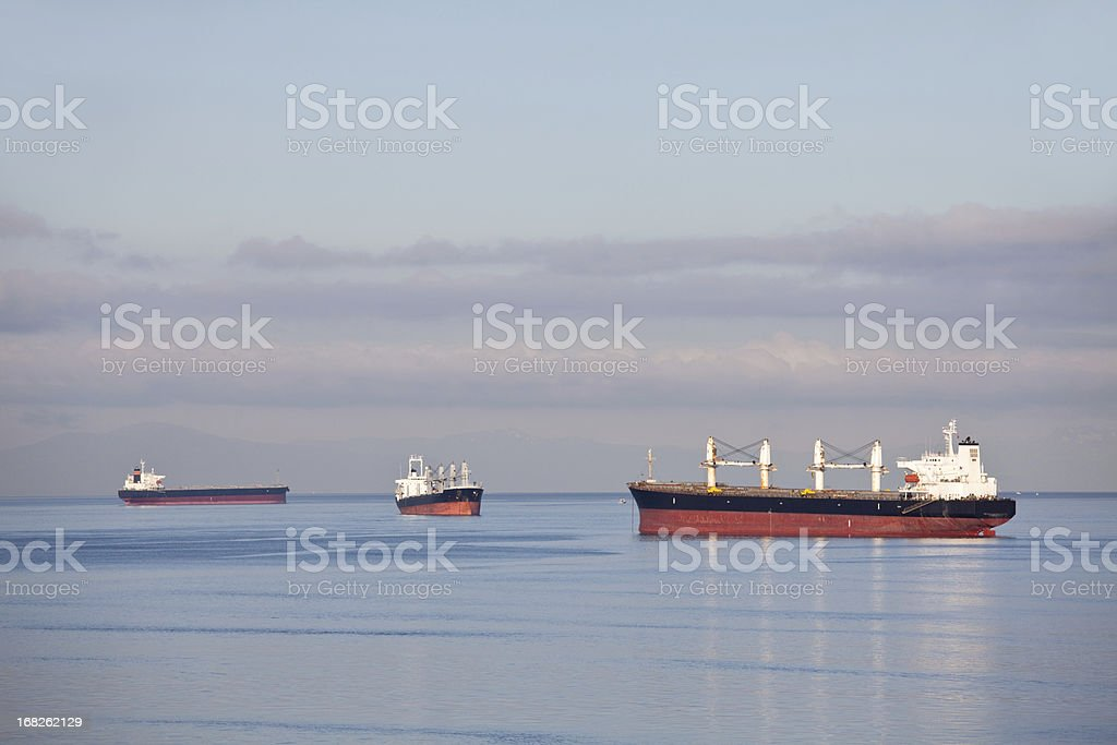Three Cargo Ships in Vancouver royalty-free stock photo