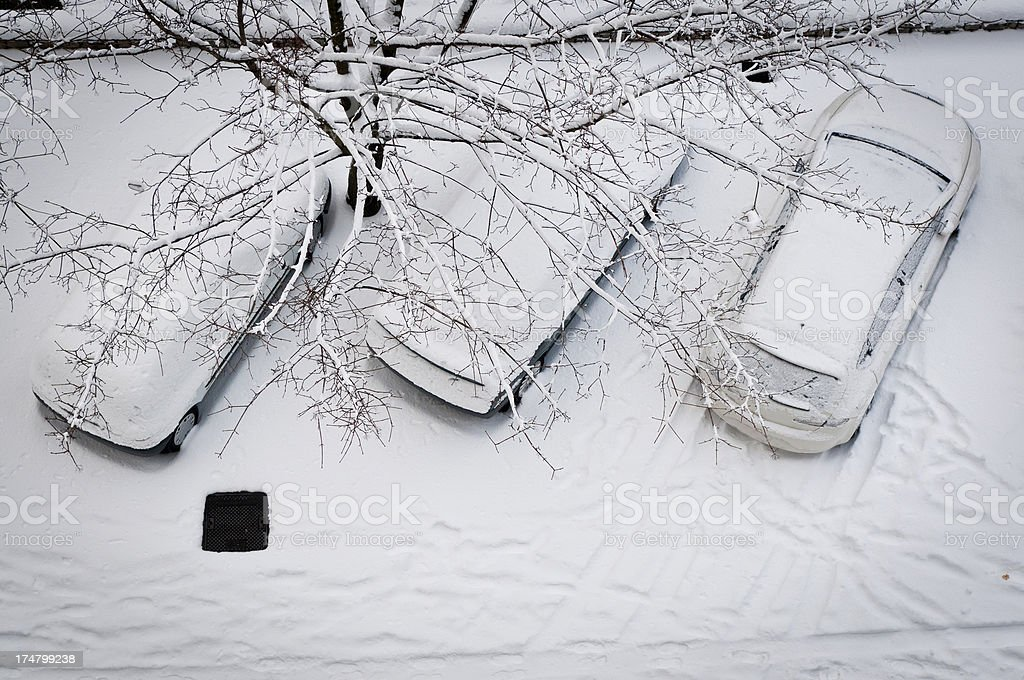 Three Cars Covered by Snow from Above royalty-free stock photo