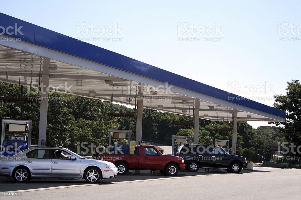 Three cars filling up at a petrol station royalty-free stock photo