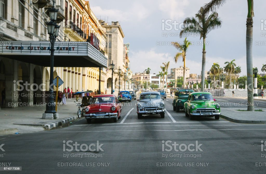Three cars line up on the street in central Havana, Cuba. royalty-free stock photo