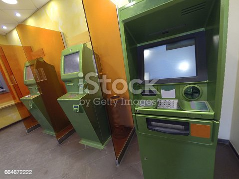 istock Three cash dispensers for issuing money green ready for work 664672222