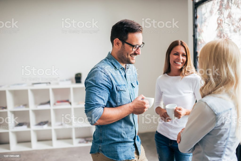 Three casual business people on the break. stock photo
