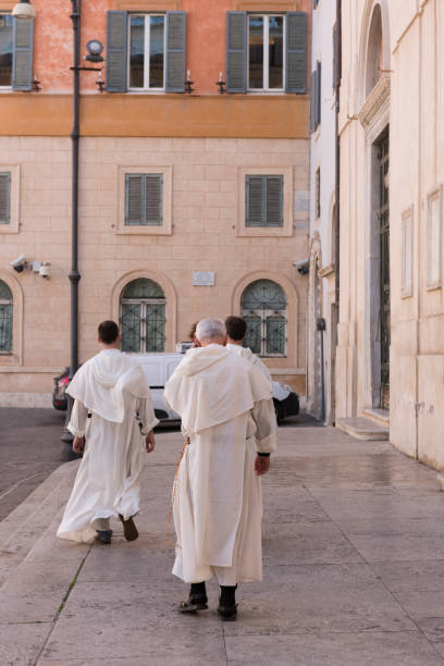 Three Catholic brothers walking together in Rome stock photo
