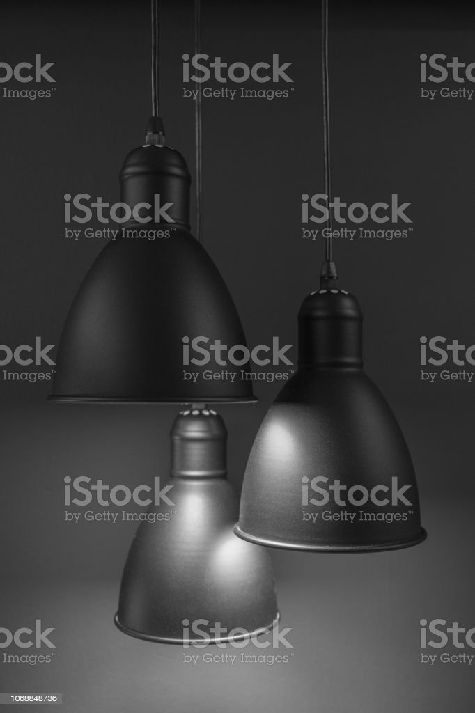 Three ceiling lamps with dark grey background stock photo