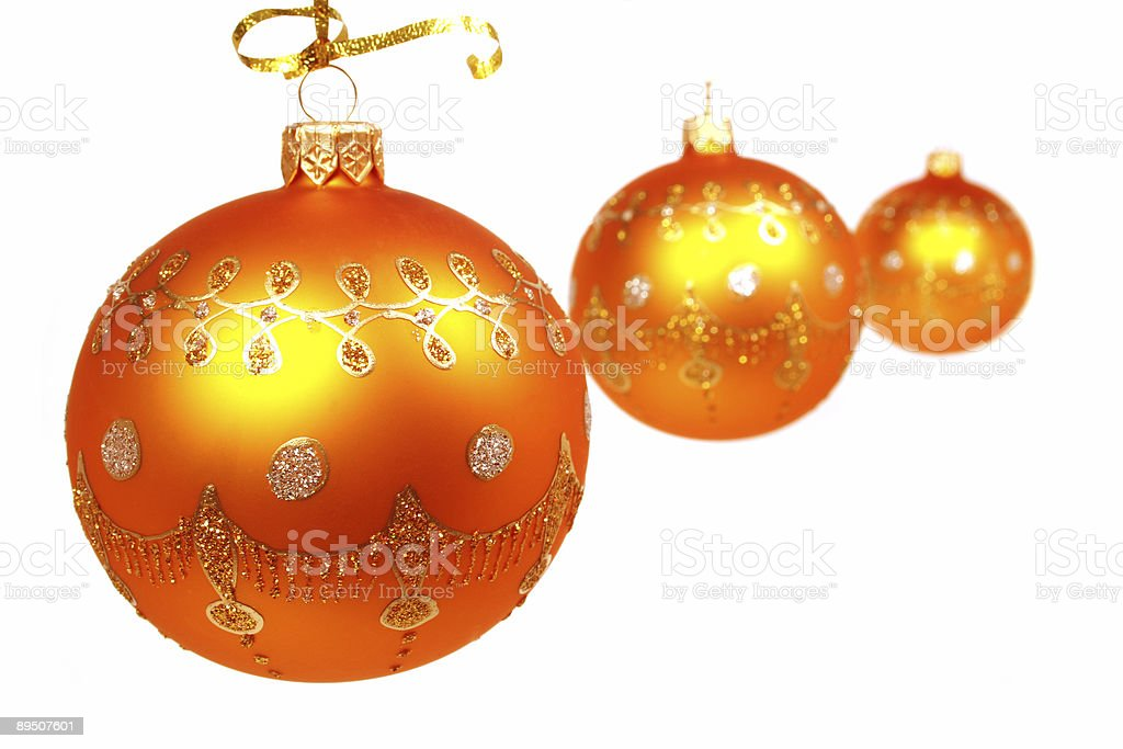 Three celebratory spheres of yellow color on white royalty-free stock photo