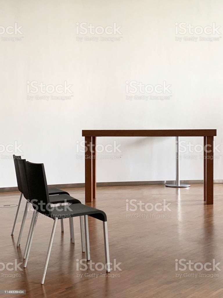 Three chairs and a table in the meeting room