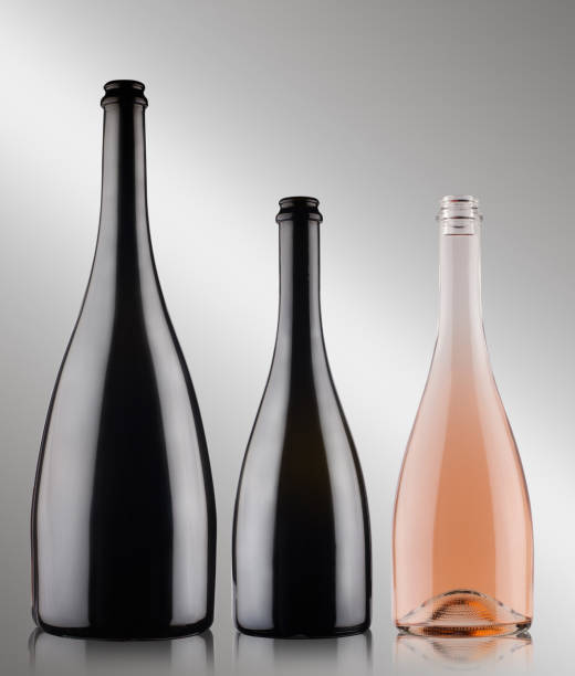 three champagne bottles on grey background stock photo