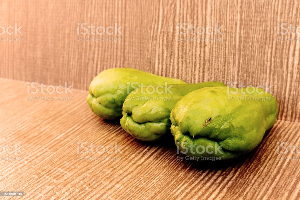 three chayote on wooden background stock photo