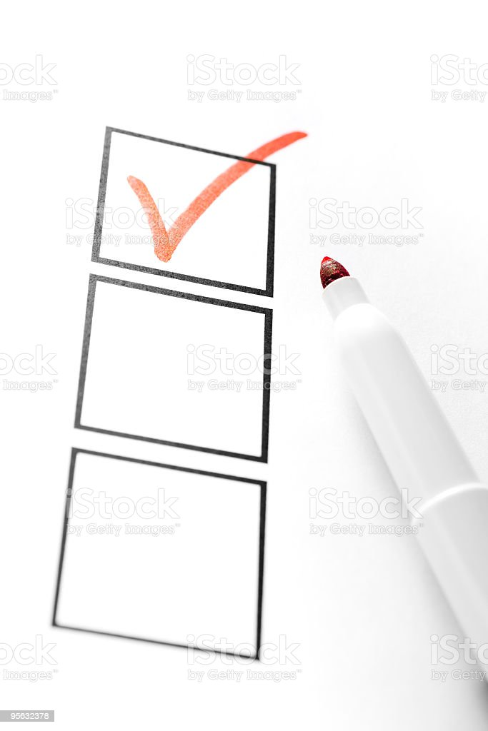 Three check boxes with one check mark royalty-free stock photo