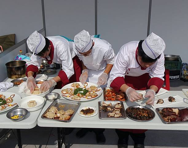 Three Chefs at a Cooking Competition stock photo
