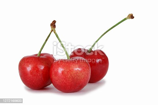 Three red cherries on a white background.