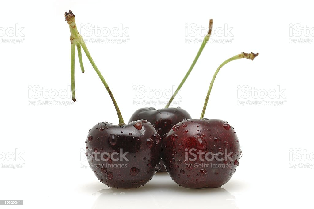 Three cherries with water drops royalty-free stock photo