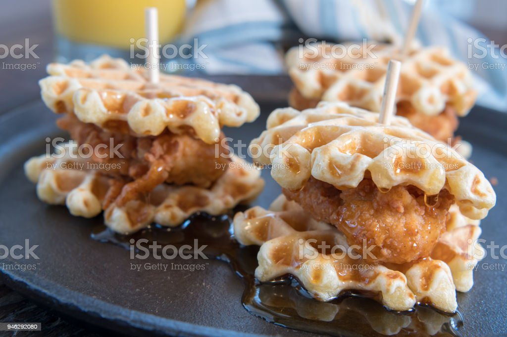 Three Chicken And Waffle Sliders with Syrup stock photo