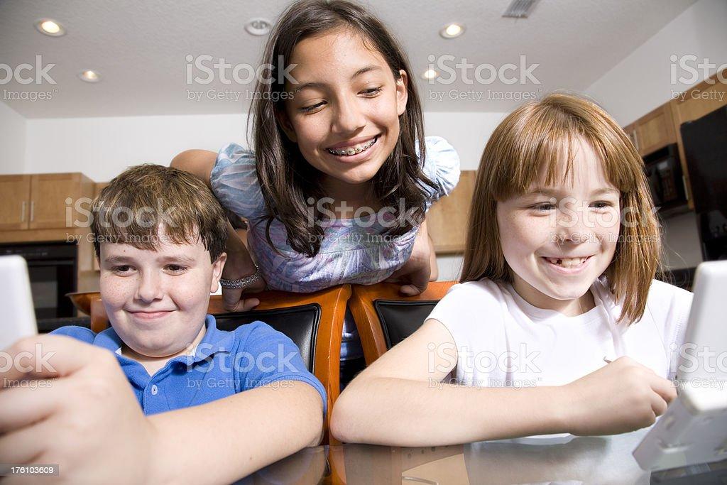 Three Children Enjoying Playing Games royalty-free stock photo