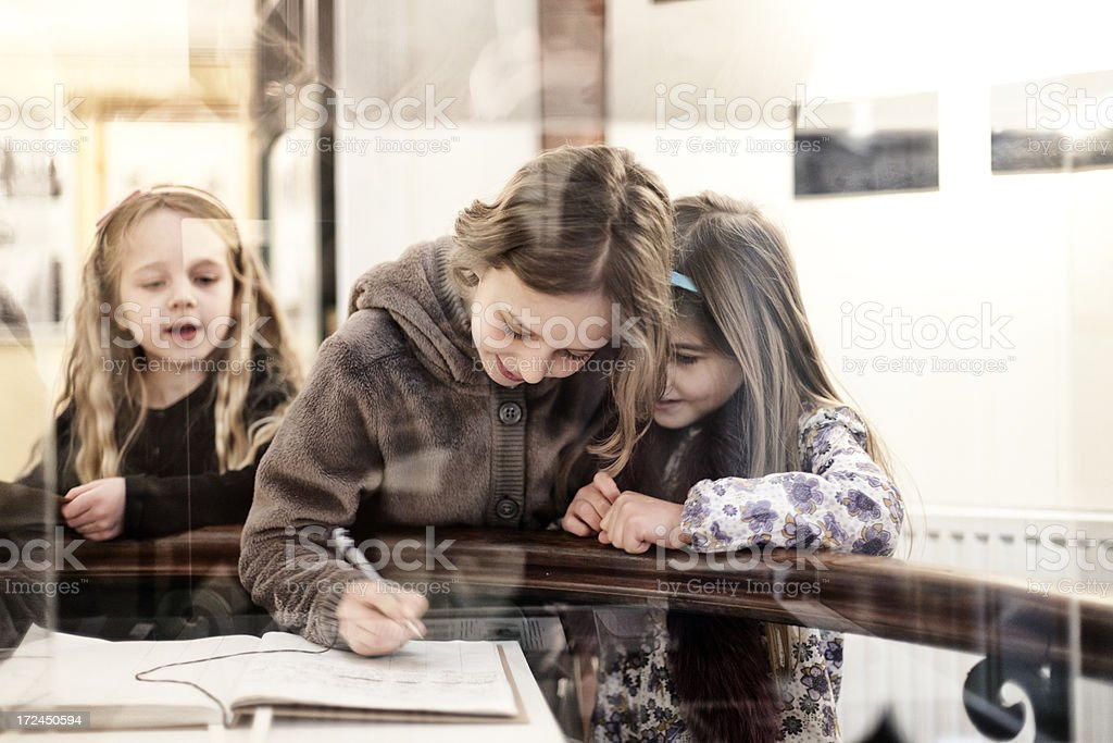 Three children in a museum royalty-free stock photo