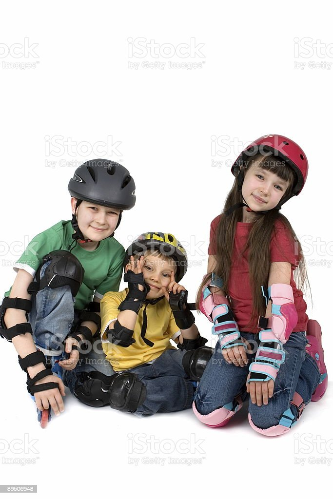 Three Children in Helmets royalty-free stock photo