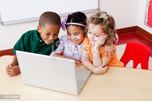istock Three children looking at the laptop together 142025856