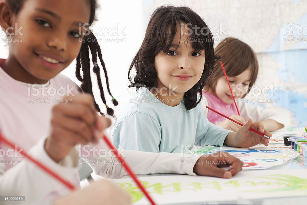 Three children painting with watercolors. royalty-free stock photo