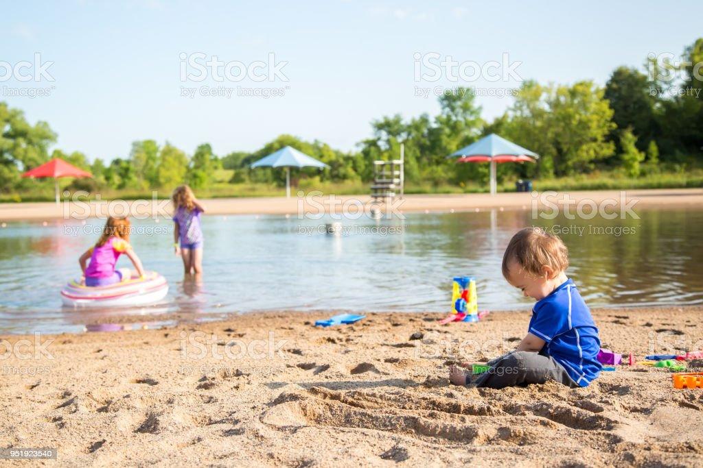 Three Children Playing at the Beach stock photo