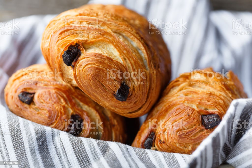 three pain au chocolat stock photo