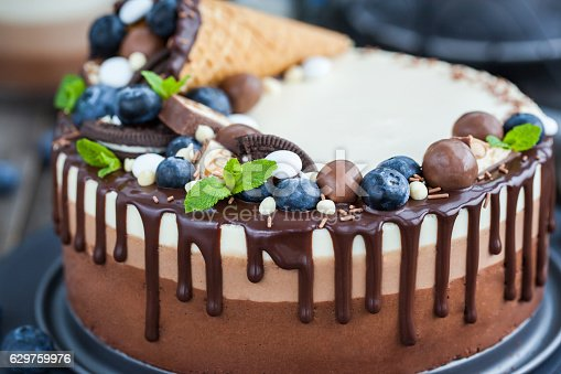 480972628 istock photo Three chocolate mousse cake decorated with waffle cone, fresh bl 629759976
