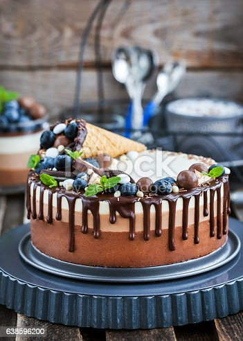 480972628 istock photo Three chocolate mousse cake decorated with waffle cone, fresh bl 638596200