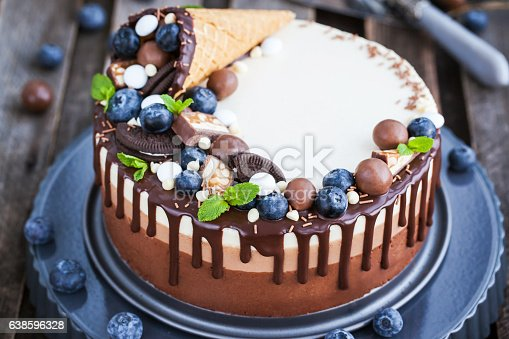 480972628 istock photo Three chocolate mousse cake decorated with waffle cone, fresh bl 638596328