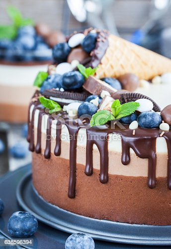 480972628 istock photo Three chocolate mousse cake decorated with waffle cone, fresh bl 638596394