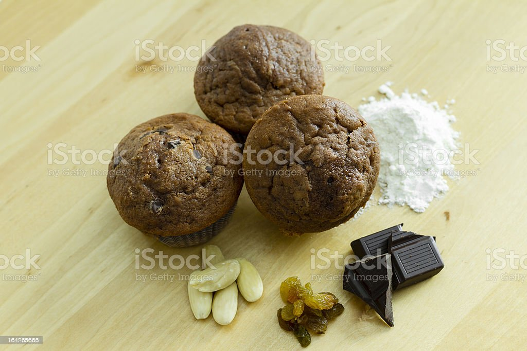 Three chocolate muffins with ingredients royalty-free stock photo