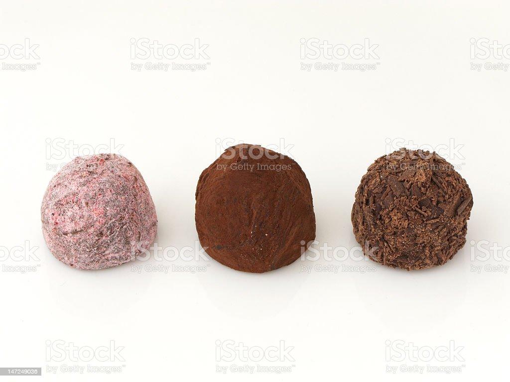 Three chocolate truffles royalty-free stock photo