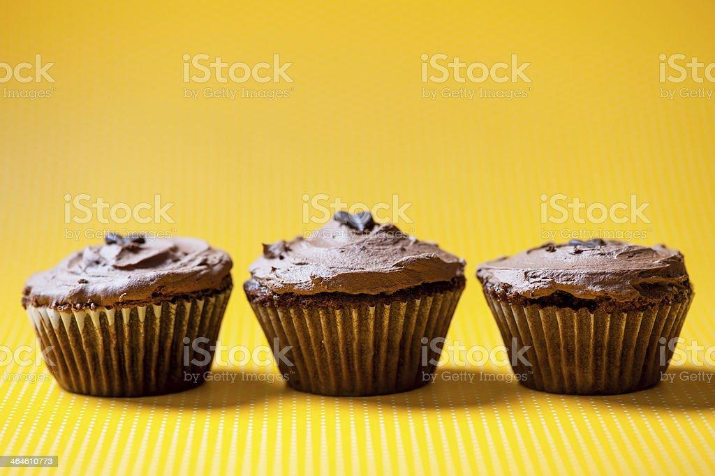 three chocolate velvet cupcakes with dark ice cream royalty-free stock photo