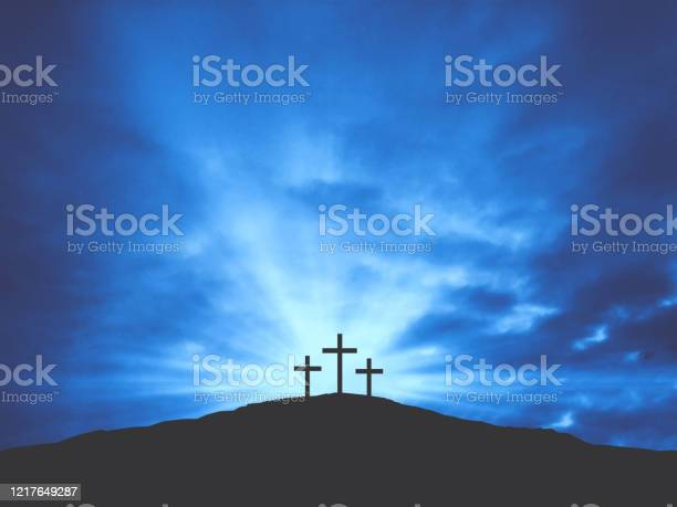 Photo of Three Christian Easter Crosses on Hill of Calvary with Blue Clouds in Sky