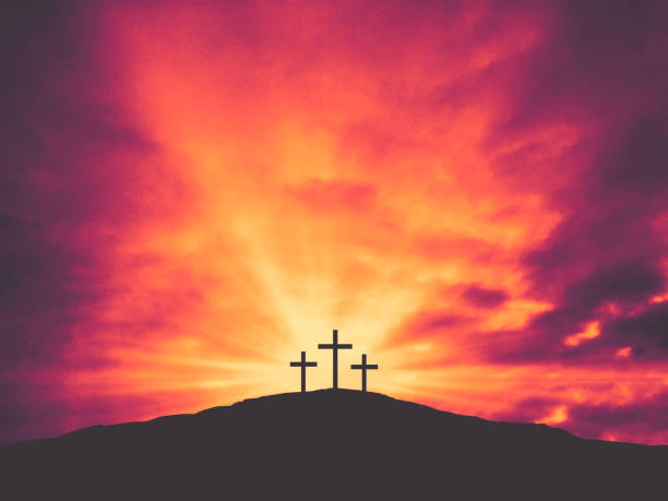Three Christian Easter Crosses on Hill of Calvary with Colorful Clouds in Sky Three Christian Easter Crosses on Hill of Calvary with Colorful Clouds in Sky - Crucifixion of Jesus Christ religious cross stock pictures, royalty-free photos & images