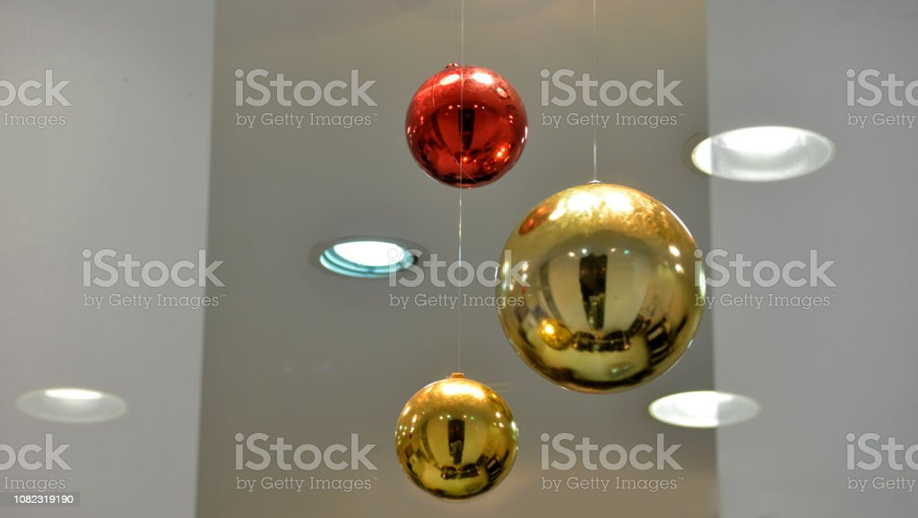 Three Christmas balls hanging in the white space