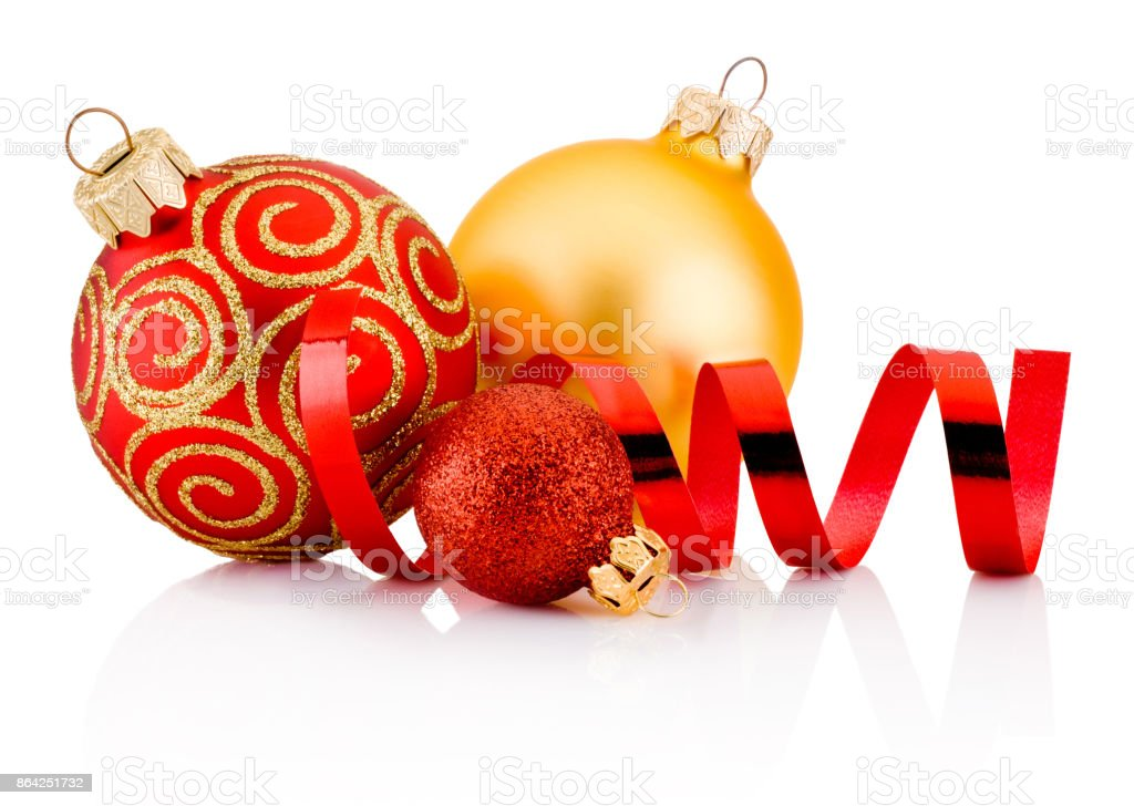 Three Christmas baubles and curling paper isolated on white background royalty-free stock photo