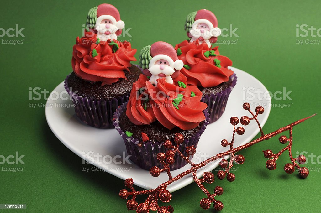 Three Christmas Cupcakes with santa decorations royalty-free stock photo