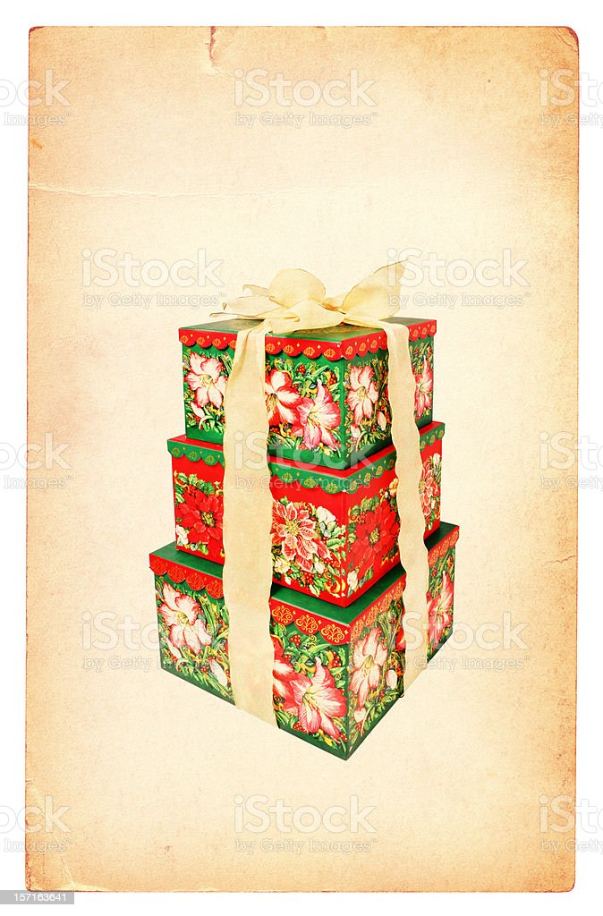Three Christmas Gifts on an Old Grunge Card royalty-free stock photo