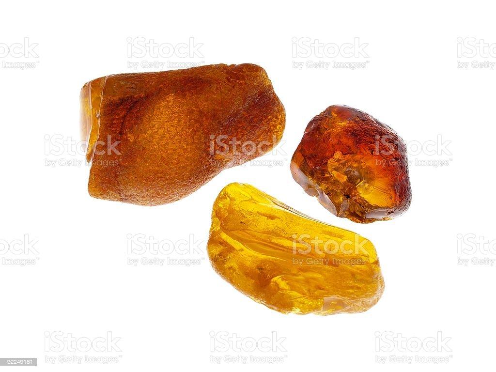 Three chunks of Polish amber stone on a white background royalty-free stock photo