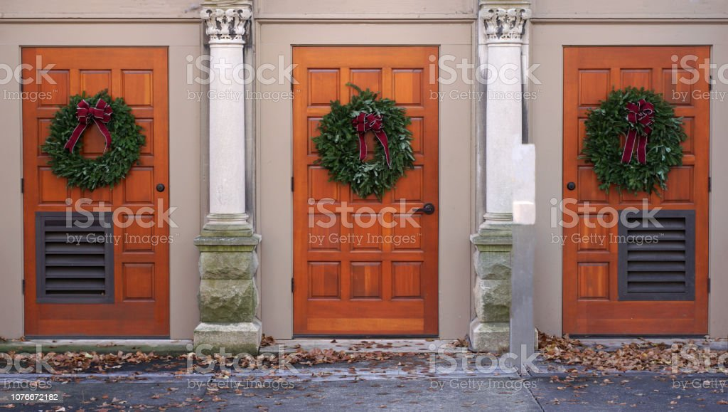 Three Church Doors With Christmas Wreaths Stock Photo Download Image Now Istock